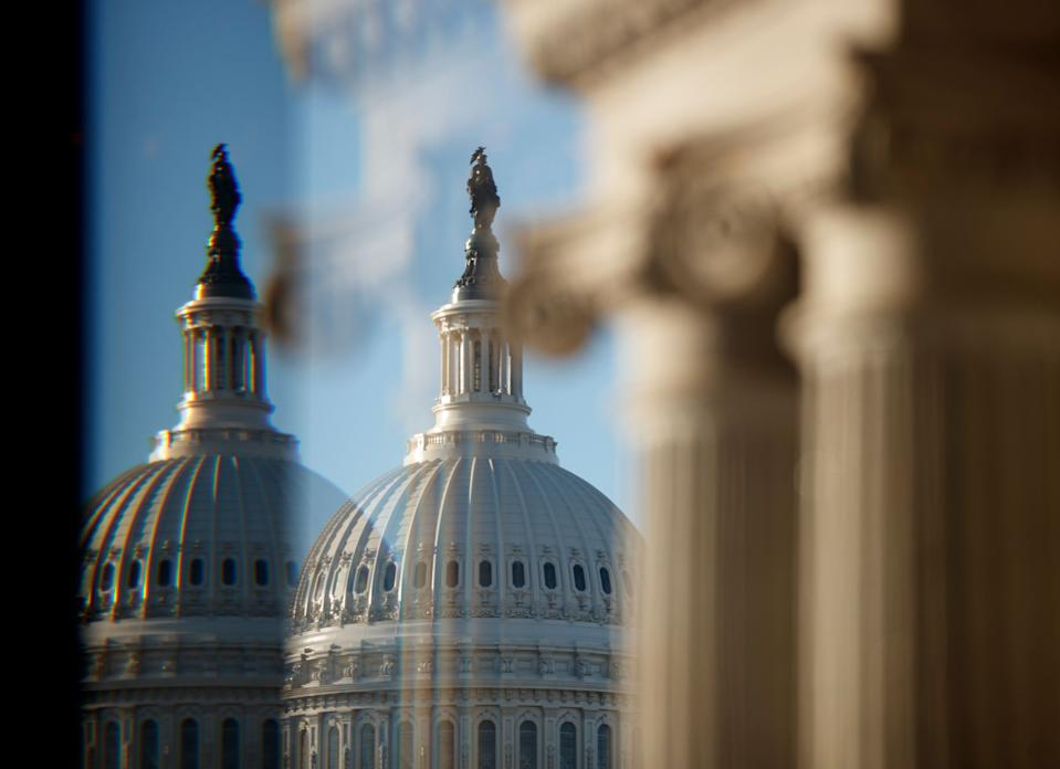 """The U.S. Capitol Building Dome is seen through a beveled window at the Library of Congress in Washington, Wednesday, Dec. 19, 2018. President Donald Trump this week appears likely to pass up his last, best chance to secure funding for the """"beautiful"""" wall he's long promised to construct along the U.S.-Mexico border. (AP Photo/Carolyn Kaster)"""
