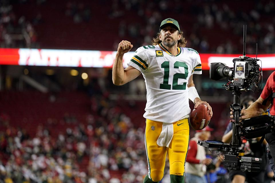 Packers quarterback Aaron Rodgers celebrates after the Packers' last-second victory Sunday night.