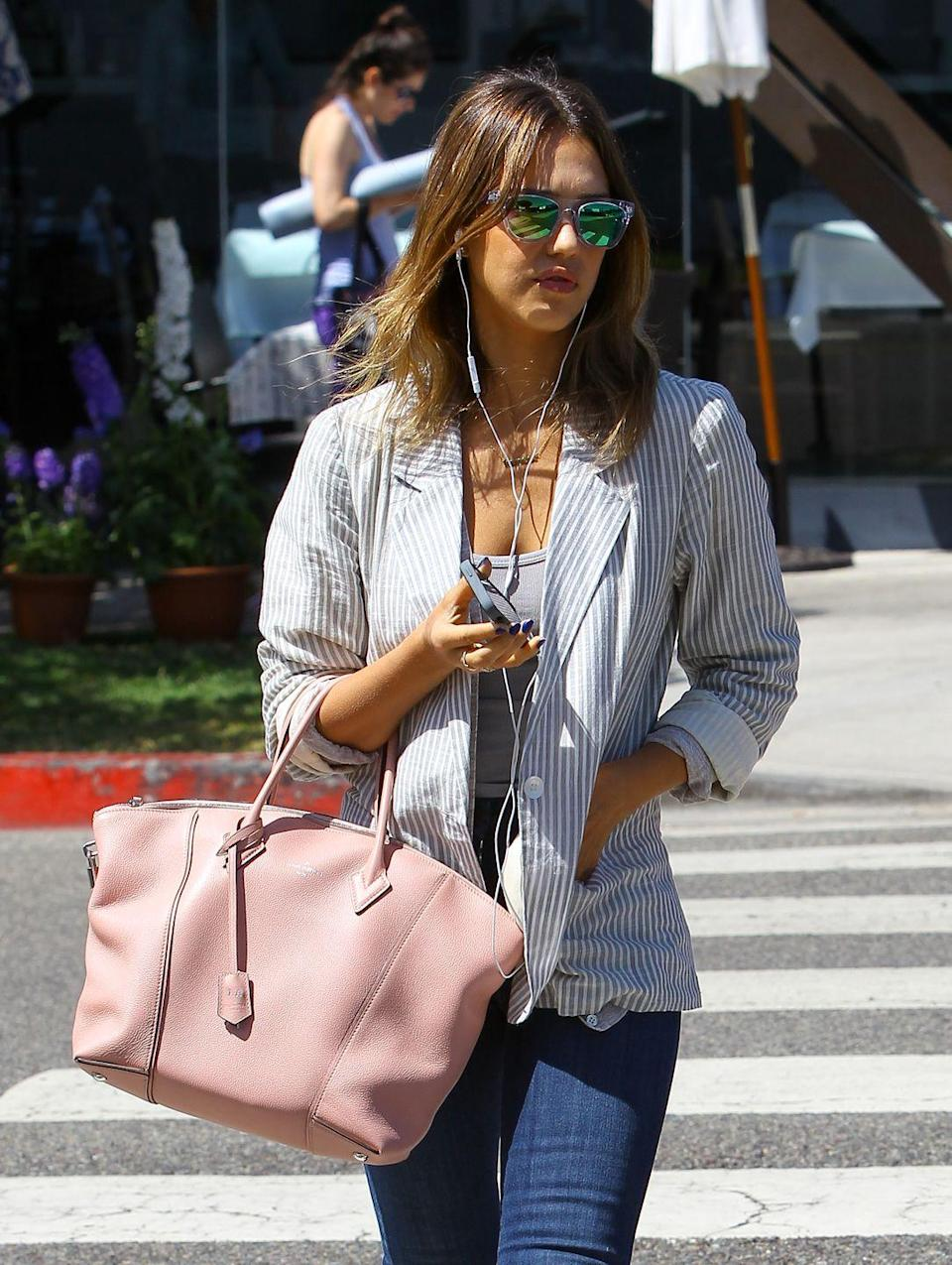 """<p>This is crucial, Jessica says. 'I definitely always have Drake, Jay-Z, Kanye, I have some new artists that I've been listening to a lot,' she told <a href=""""https://www.byrdie.com/jessica-alba-diet-fitness-tips"""" rel=""""nofollow noopener"""" target=""""_blank"""" data-ylk=""""slk:Byrdie"""" class=""""link rapid-noclick-resp"""">Byrdie</a>. 'I like any kind of West Coast rapper—usually more hip-hop and rap and less pop music.' <br></p>"""