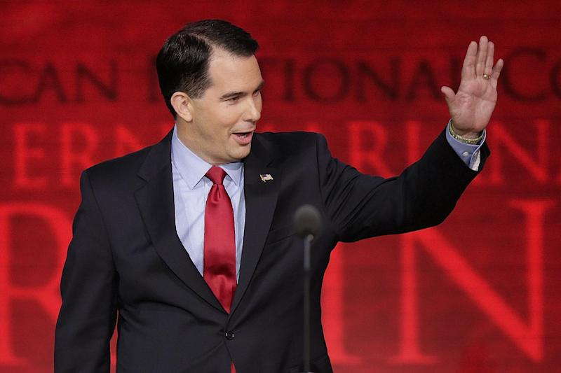 Wisconsin Gov. Scott Walker waves to delegates during the Republican National Convention in Tampa, Fla., on Tuesday, Aug. 28, 2012. (AP Photo/J. Scott Applewhite)