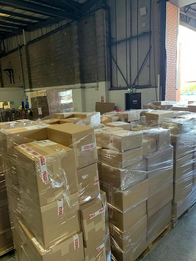 Boxes being delivered to locations around the world. (SWNS)