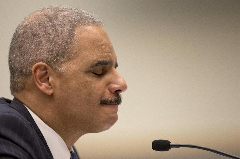 Attorney General Eric Holder pauses as he testifies on Capitol Hill in Washington, Wednesday, May 15, 2013, before the House Judiciary Committee oversight hearing on the Justice Department. Holder is expected to face aggressive questioning on topics ranging from the Justice Department's gathering of phone records at the Associated Press to the government's handling of intelligence before the Boston Marathon bombings. (AP Photo/Carolyn Kaster)