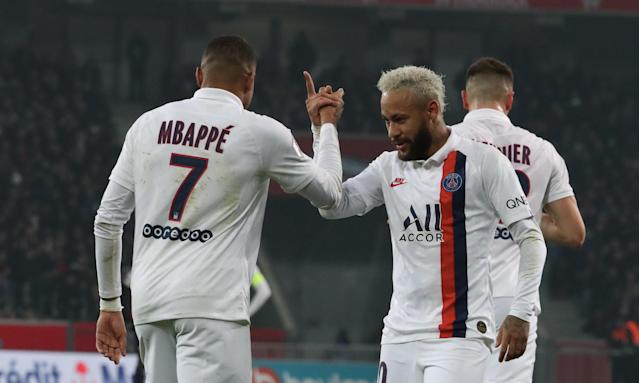 Neymar (right), Kylian Mbappe and Paris Saint-Germain were awarded the French title two days after the Ligue 1 season was cancelled because of the coronavirus. (Franck Fife/Getty)