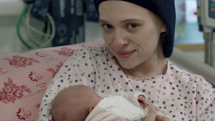 Ultra-Orthodox woman holds baby in press photo for Netflix show