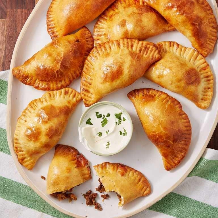 """<p>Get crispy, flaky empanadas with a little help from the air fryer.</p><p><em><a href=""""https://www.delish.com/cooking/recipe-ideas/a52606/beef-empanadas-recipe/"""" rel=""""nofollow noopener"""" target=""""_blank"""" data-ylk=""""slk:Get the recipe from Delish »"""" class=""""link rapid-noclick-resp"""">Get the recipe from Delish »</a></em></p>"""
