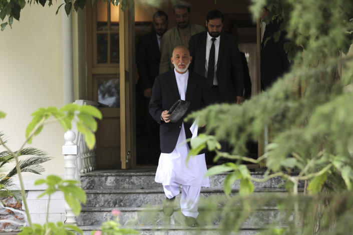 Afghanistan's former President Hamid Karzai arrives for a news conference in Kabul, Afghanistan, Tuesday, July 13, 2021. Former President Karzai calls on both the Afghan government and the Taliban to resume negotiations and end fighting in the country. (AP Photo/Rahmat Gul)