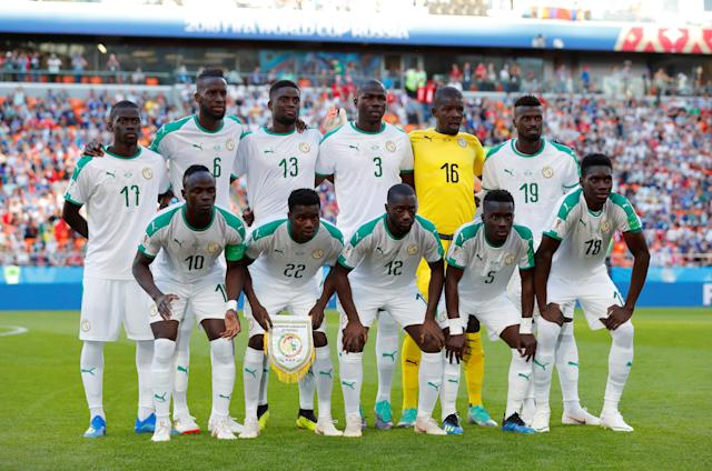 Soccer Football - World Cup - Group H - Japan vs Senegal - Ekaterinburg Arena, Yekaterinburg, Russia - June 24, 2018 Senegal players pose for a team group photo before the match REUTERS/Andrew Couldridge