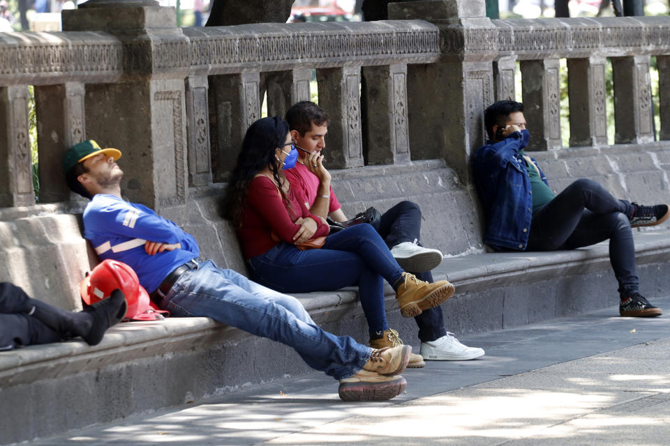MEXICO CITY, MEXICO - MAY 25, 2021: Persons wear protective masks as preventive measure against the virus while take a rest during the Covid-19 situation in Mexico on May 25, 2021 in Mexico City, Mexico. (Photo credit should read Luis Barron / Eyepix Group/Barcroft Media via Getty Images)