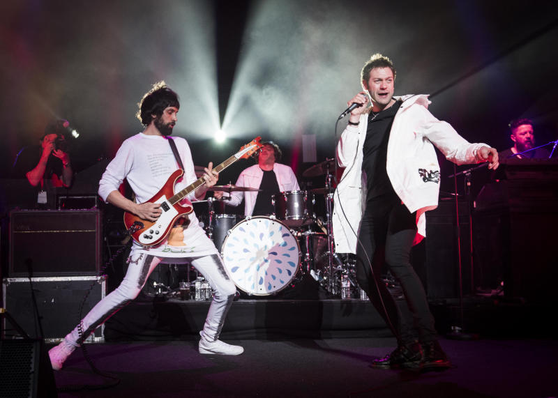 Sergio Pizzorno and Tom Meighan from Kasabian on stage during the Teenage Cancer Trust annual concert series, at the Royal Albert Hall, London.