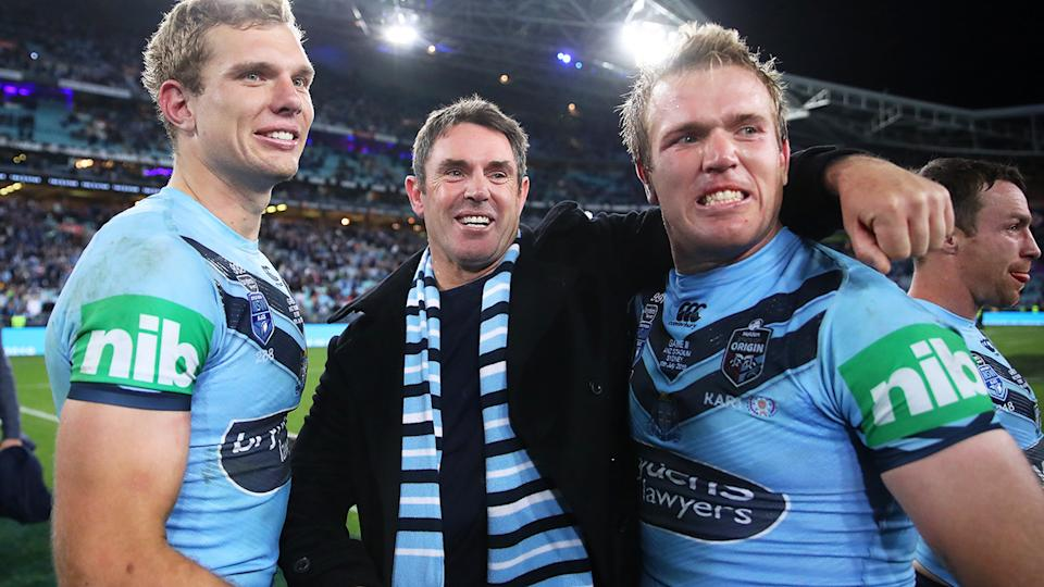 Brad Fittler, pictured here celebrating with Tom and Jake Trbojevic after NSW won the 2019 State of Origin series.