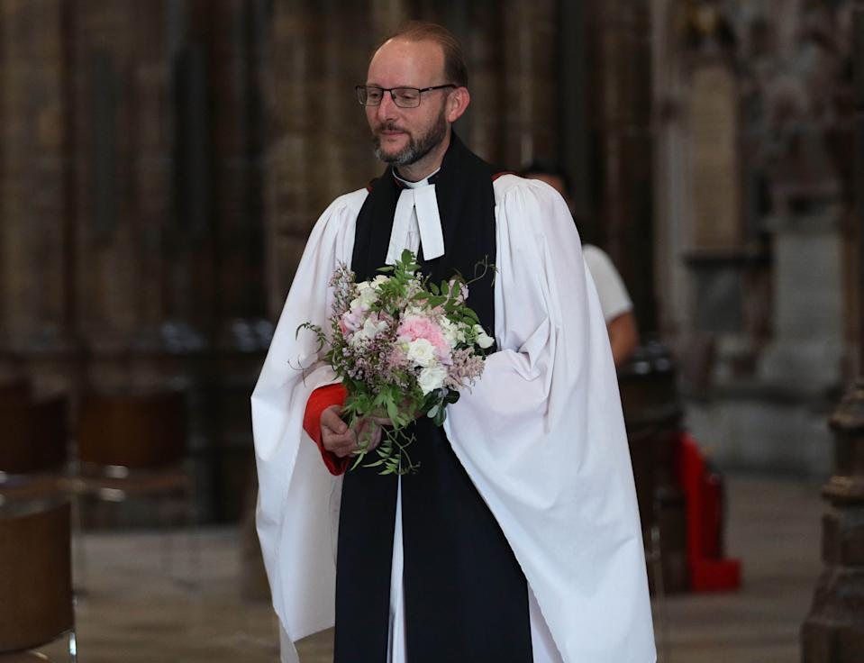 Embargoed: Not for publication or onward transmission before 2200 BST Saturday July 18, 2020. NEWS EDITORIAL USE ONLY. NO COMMERCIAL USE. NO MERCHANDISING, ADVERTISING, SOUVENIRS, MEMORABILIA or COLOURABLY SIMILAR. Reverend Anthony Ball, Canon of Westminster in Westminster Abbey in London with Princess Beatrice's wedding bouquet which, like those of Royal brides, is traditionally placed on the Tomb of the Unknown Warrior.