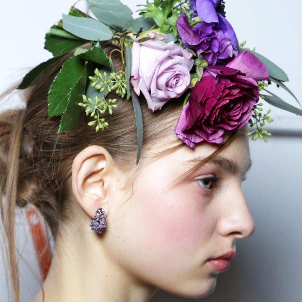 <p>This next-level flower crown isn't a crown at all. At Marchesa, hairstylist Antonio Corral Calero used a needle and thread to sew fresh blooms into the models' hair. And it'd be as pretty on May day as it would be at your best friend's wedding.</p>