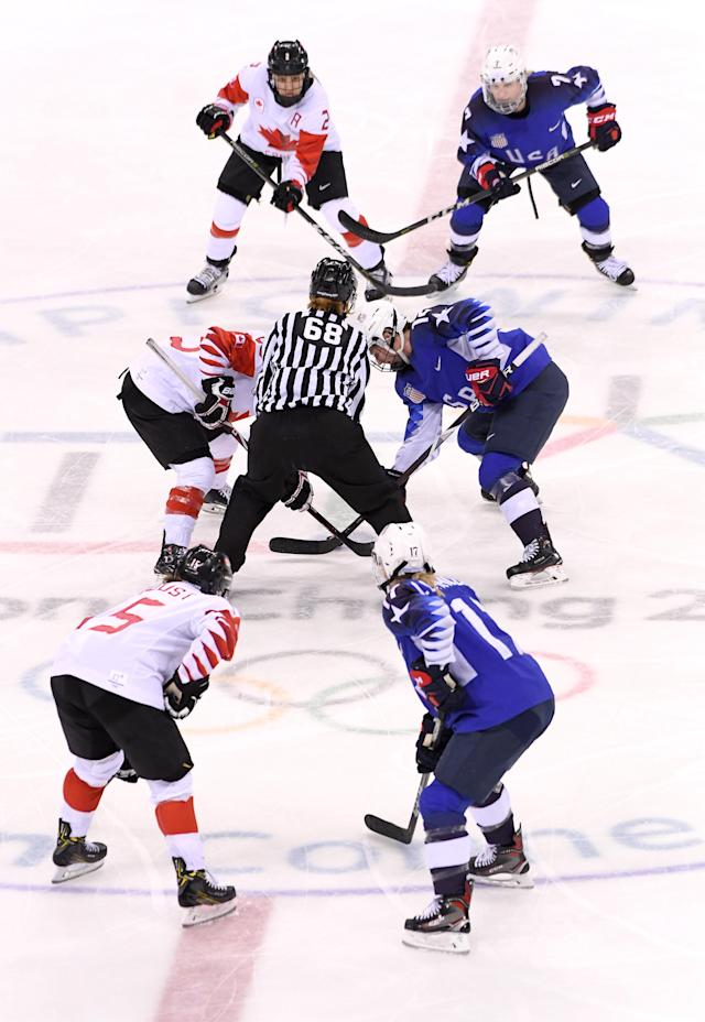 <p>Marie-Philip Poulin #29 of Canada faces off against Kelly Pannek #12 of the United States in the third period during the Women's Gold Medal Game on day thirteen of the PyeongChang 2018 Winter Olympic Games at Gangneung Hockey Centre on February 22, 2018 in Gangneung, South Korea. (Photo by Harry How/Getty Images) </p>