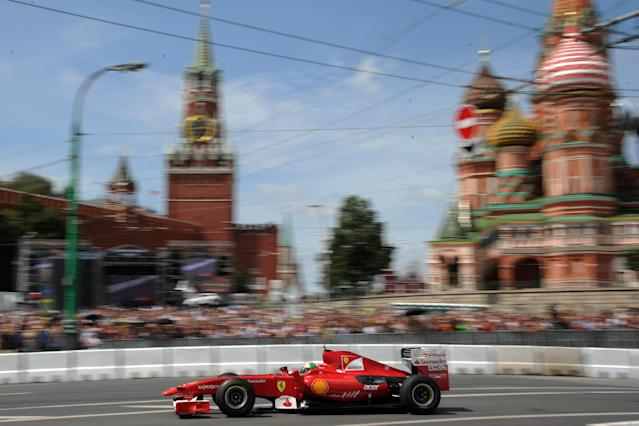 """Formula One Scuderia Ferrari team driver Giancarlo Fisichella speeds past St. Basil's Cathedral during the """"Moscow City Racing"""" show on July 15, 2012 in central Moscow. AFP PHOTO / KIRILL KUDRYAVTSEVKIRILL KUDRYAVTSEV/AFP/GettyImages"""
