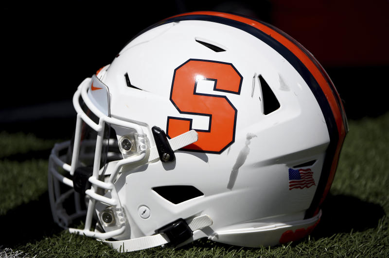 A detailed view of a Syracuse Orange football helmet during the first half of an NCAA college football game against the Maryland Terrapins, Saturday, Sept. 7, 2019, in College Park, Md. (AP Photo/Will Newton)