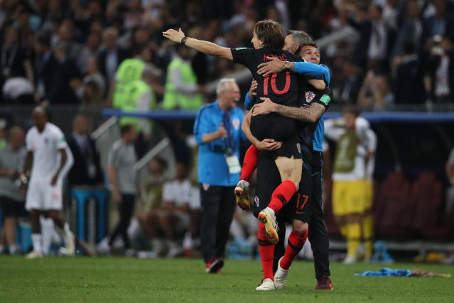 <p>Luka Modric of Croatia and Mario Mandzukic of Croatia celebrate reaching the World Cup final during the 2018 FIFA World Cup Russia Semi Final match between England and Croatia at Luzhniki Stadium on July 11, 2018 in Moscow, Russia. (Photo by Matthew Ashton – AMA/Getty Images) </p>