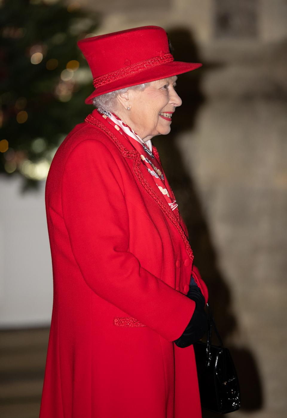 WINDSOR, ENGLAND - DECEMBER 08:  Queen Elizabeth II waist to thank local volunteers and key workers for the work they are doing during the coronavirus pandemic and over Christmas in the quadrangle of Windsor Castle on December 8, 2020 in Windsor, England (Photo by Pool/Samir Hussein/WireImage)