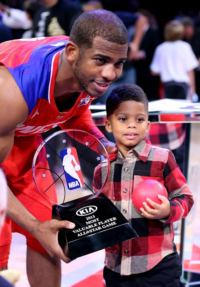 HOUSTON, TX - FEBRUARY 17: Chris Paul #3 of the Los Angeles Clippers and the Western Conference celebrates with son Christopher Emmanuel Paul ll after winning MVP in the 2013 NBA All-Star game at the Toyota Center on February 17, 2013 in Houston, Texas. NOTE TO USER: User expressly acknowledges and agrees that, by downloading and or using this photograph, User is consenting to the terms and conditions of the Getty Images License Agreement. (Photo by Ronald Martinez/Getty Images)