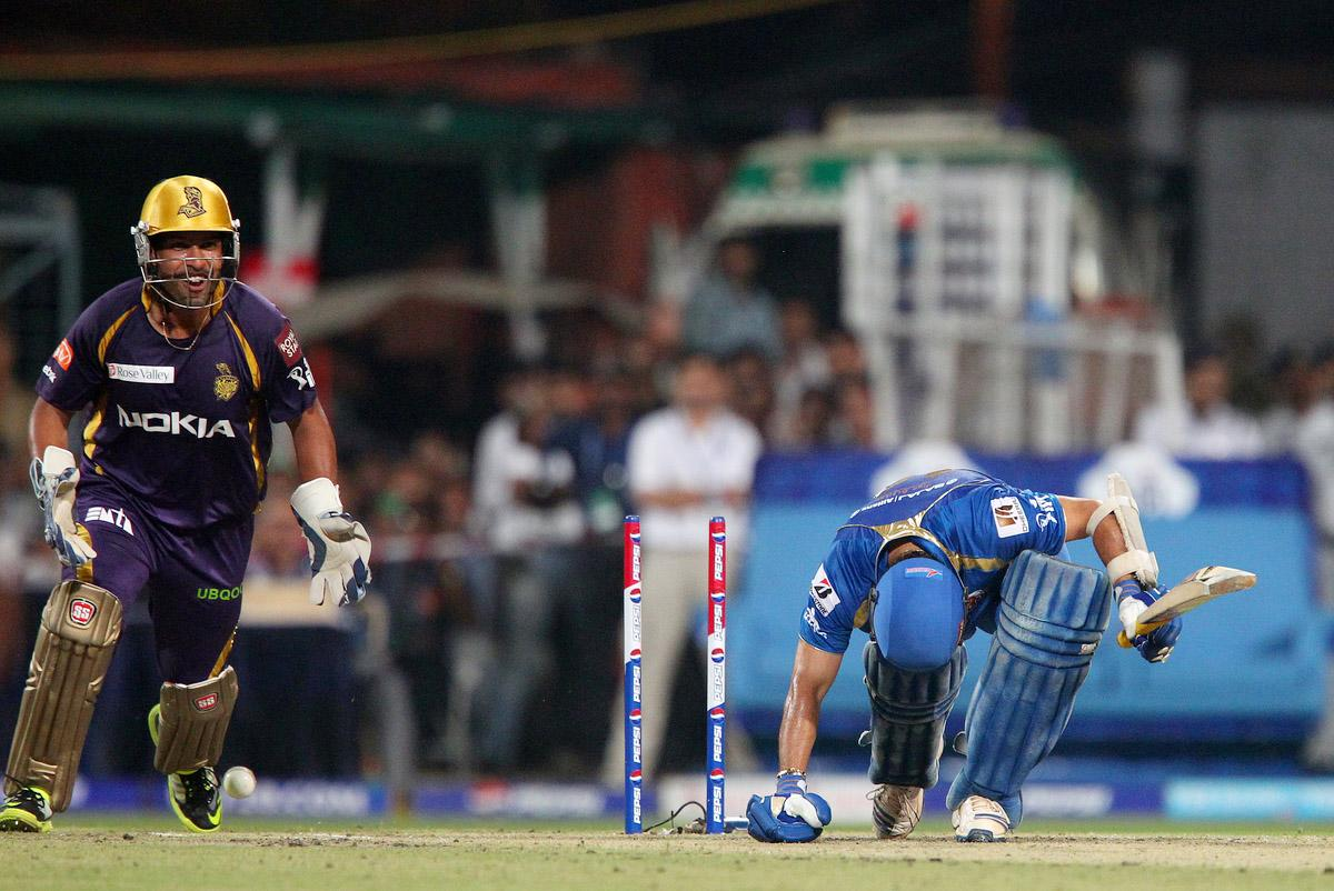 Sachin Tendulkar bows his head after being bowled as Debradata Das celebrates his wicket during match 33 of the Pepsi Indian Premier League between The Kolkata Knight Riders and the Mumbai Indians held at the Eden Gardens Stadium in Kolkata on the 24th April 2013. (BCCI)