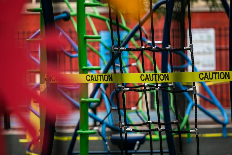 FILE PHOTO: A caution tape is put up around the playground at Public School 33 following the outbreak of the coronavirus disease (COVID-19) in the Manhattan borough of New York City