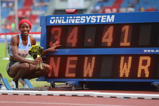 Shaunae Miller-Uibo from Bahamas celebrates after she won the women's 300 meters event in a new world record, at the Golden Spike athletics IAAF World Challenge in Ostrava, Czech Republic, Thursday, June 20, 2019 (Jaroslav Ozana/CTK via AP)