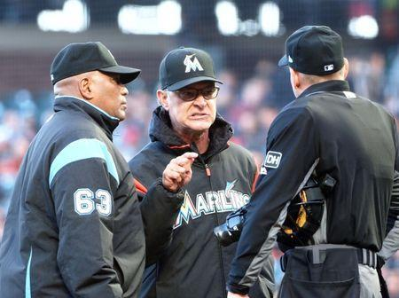 Jun 19, 2018; San Francisco, CA, USA; Miami Marlins manager Don Mattingly (8) argues with the umpires after a player was hit by pitch by the San Francisco Giants during the second inning at AT&T Park. Mandatory Credit: Kelley L Cox-USA TODAY Sports