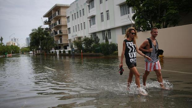 A combination of the lunar orbit causing seasonal high tides and rising sea levels due to climate change produced this flooded street in Miami Beach on September 29, 2015. Hundreds of millions of dollars are being invested in infrastructure to keep ocean waters from inundating the city. / Credit: Joe Raedle/Getty Images