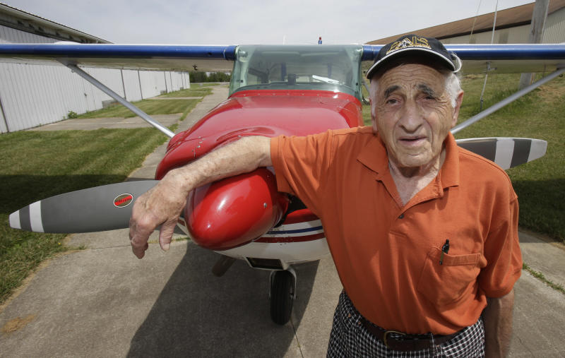 In this Thursday, May 30, 2013 photo, John Lawton poses by his Cessna 172 airplane in Wadsworth, Ohio. Lawton will attempt to make 90 flying passages across the U.S.-Canadian border. Lawton says he's been a pilot for 56 years and got it in his head to do something different for his birthday this year. He plans a series of figure-eight maneuvers above the Niagara River on Grand Island, north of Buffalo, N.Y., that will take him back and forth across the northern border. (AP Photo/Tony Dejak)