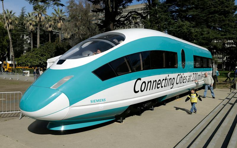 This 2015 photo shows a a full-scale mock-up of a high-speed train that was displayed at the Capitol in Sacramento. The $77 billion project was dealt a big blow recently when Gov. Gavin Newsom told lawmakers that he wanted to drastically scale the project back to one line in the Central Valley.