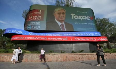FILE PHOTO: A screen advertises the campaign of Kazakh interim president and candidate in the upcoming presidential election Tokayev in Almaty
