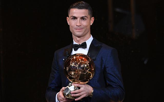 "<a class=""link rapid-noclick-resp"" href=""/soccer/players/cristiano-ronaldo/"" data-ylk=""slk:Cristiano Ronaldo"">Cristiano Ronaldo</a> accepted his fifth world player of the year trophy halfway up the Eiffel Tower. (The Telegraph)"
