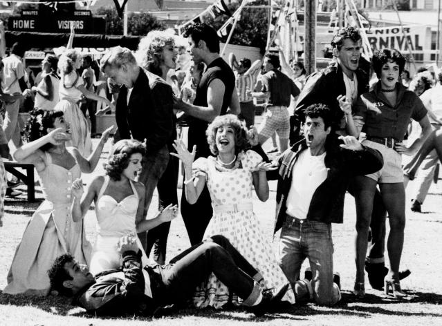 """The <em>Grease</em>cast performs """"We Go Together."""" Clockwise from the left: Michael Tucci as Sonny (on ground), Dinah Manoff as Marty, Jamie Donnelly as Jan, Kelly Ward as Putzie, Olivia Newton-John as Sandy, John Travolta as Danny, Jeff Conaway as Kenickie, Stockard Channing as Rizzo, Barry Pearl as Doody, and Didi Conn as Frenchie. (Photo: Paramount Pictures/courtesy of the Everett Collection)"""