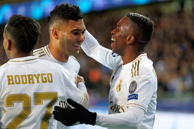 BRUGGE, BELGIUM - DECEMBER 11: Real Madrid Vinicius Junior (R) celebrates with Casemiro and Rodrygo after scoring goal during the UEFA Champions League group A match between Club Brugge KV and Real Madrid at Jan Breydel Stadium on December 11, 2019 in Brugge, Belgium. (Photo by Sylvain Lefevre/Getty Images)