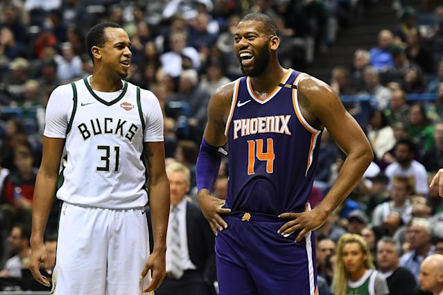 Greg Monroe (right) smiles like a man who just got set free to find a new home in time for the playoffs. (Getty)