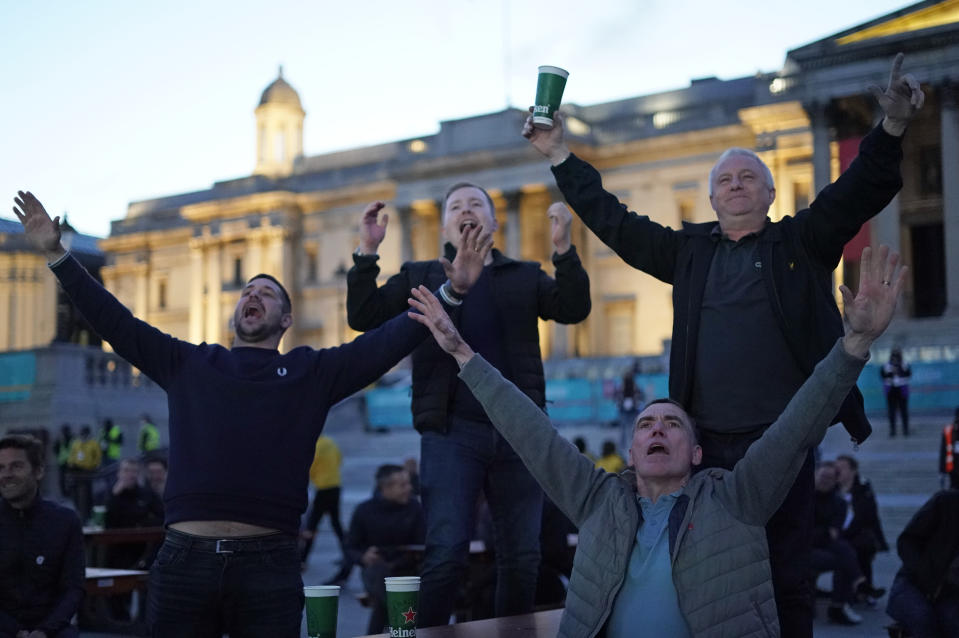 England supporters react in the fan zone in Trafalgar Square in London, Tuesday, June 22, 2021 during the Euro 2020 soccer championship group D match between England and the Czech Republic at Wembley Stadium. (AP Photo/Alberto Pezzali)