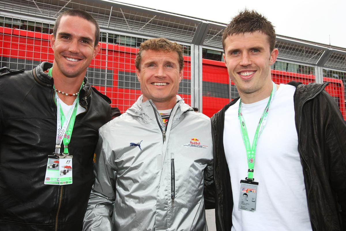 David Coulthard (C) of Great Britain and Red Bull Racing meets England cricketer Kevin Pietersen (L) and Manchester United footballer Michael Carrick (R) on the grid before the British Formula One Grand Prix at Silverstone on July 6, 2008 in Northampton, England.  (Photo by Mark Thompson/Getty Images)