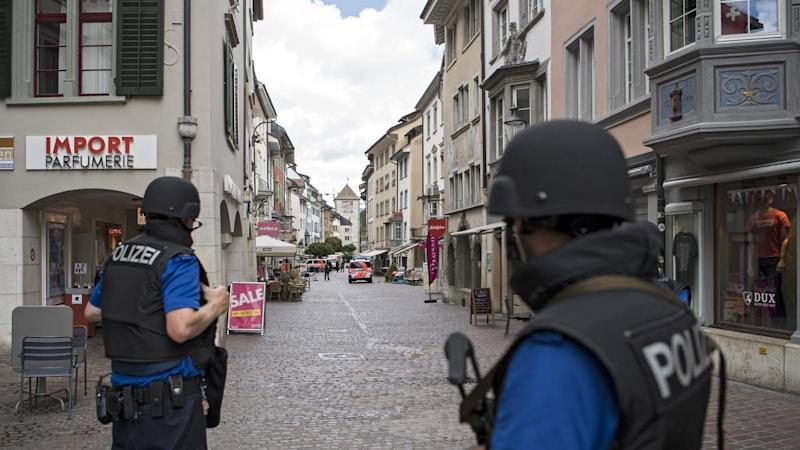 Police have shut down the Swiss town of Schaffhausen as they hunt for a man wielding a chainsaw.