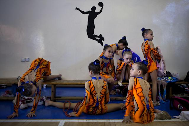In this Nov. 9, 2012 photo, gymnasts from Russian-speaking immigrant families warm up at a gymnastics competition organized for Israel's immigrant community, in the southern resort city of Eilat. Most of Israel's Olympic gymnasts are immigrants from the former Soviet Union. (AP Photo/Oded Balilty)