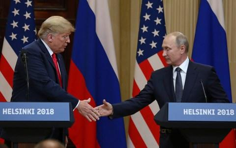 President Donald Trump shakes hands with Russian President Vladimir Putin during a joint press conference at the Presidential Palace in Helsinki, Finland on July 16 - Credit: Barcroft/UPI