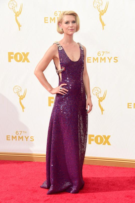 "<p>Claire Danes loves to take risks and this Prada dress certainly is one. Like a pink and purple brick wall, the ""Homeland"" star's gown was held up with chain link straps, which weaved throughout the piece. </p>"