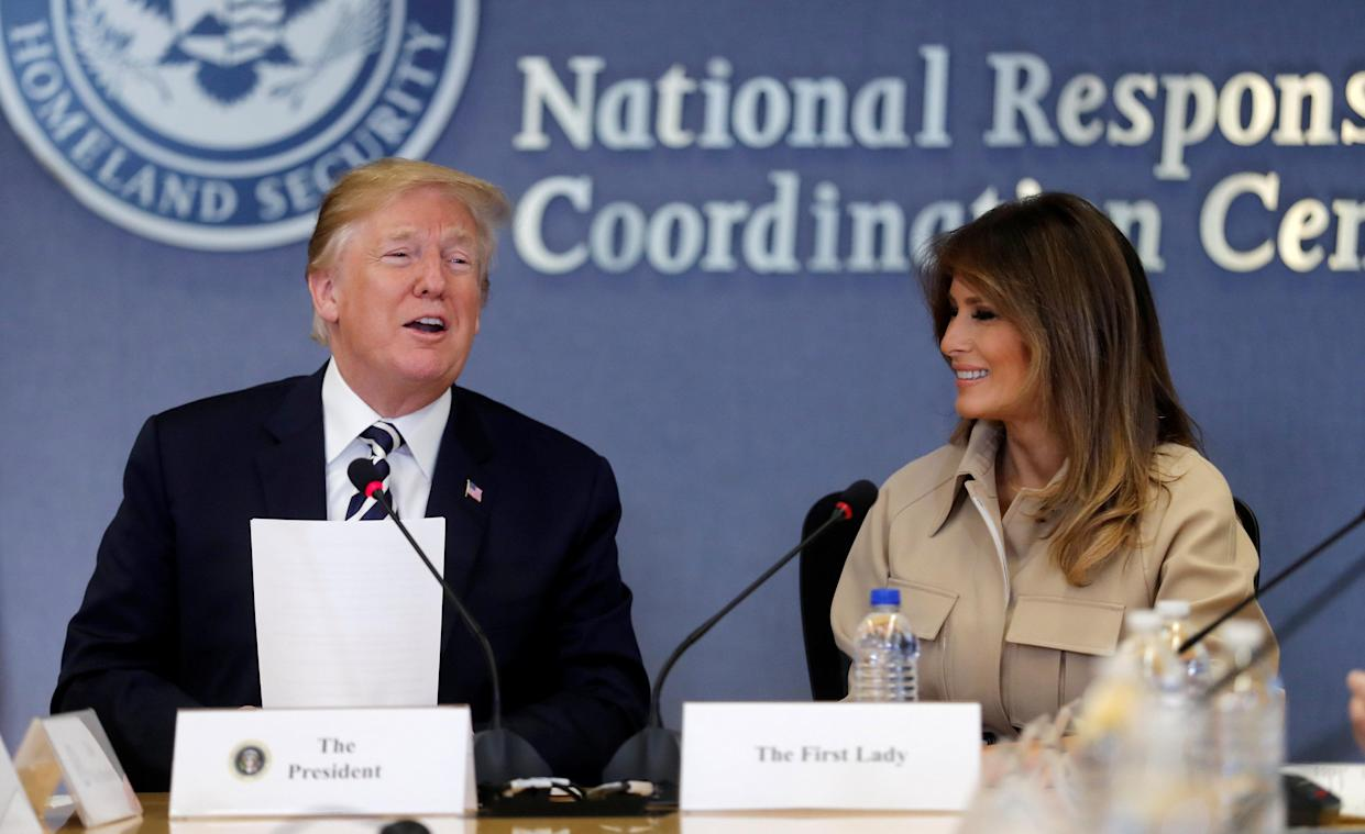 First lady Melania Trump appears with President Trump at a hurricane response briefing at the FEMA headquarters in Washington, D.C., on Wednesday. (Carlos Barria/Reuters)