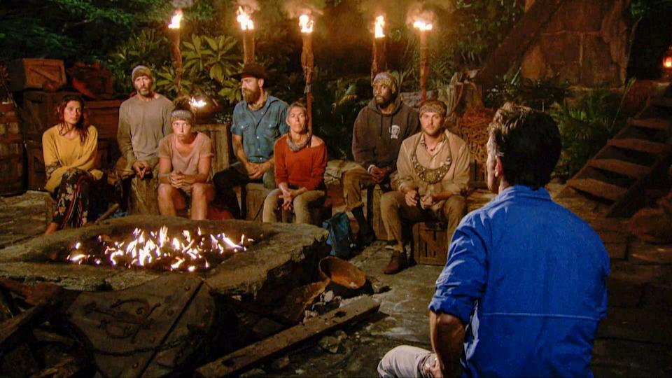 "Michele Fitzgerald, Tony Vlachos, Sarah Lacina, Ben Driebergen, Denise Stapley, Jeremy Collins and Nick Wilson at Tribal Council during an episode of ""Survivor: Winners at War."" (Photo: CBS Photo Archive via Getty Images)"