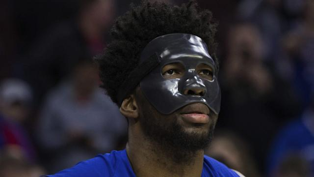 Joel Embiid, clearly frustrated with watching the 76ers lose a home playoff game from the sideline, lashed out with a profane Instagram message after Monday's game. (AP)