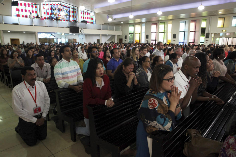 In this Sunday, Jan. 20, 2019 photo, parishioners attend Mass at St. Mary's Catholic Church in Dubai, United Arab Emirates. Pope Francis' visit to the United Arab Emirates from Feb. 3 through Feb. 5, marks the first ever papal visit to the Arabian Peninsula, the birthplace of Islam. The Catholic Church believes there are some 1 million Catholics in the UAE today. The backbone of that population is Filipino and Indian. (AP Photo/Jon Gambrell)