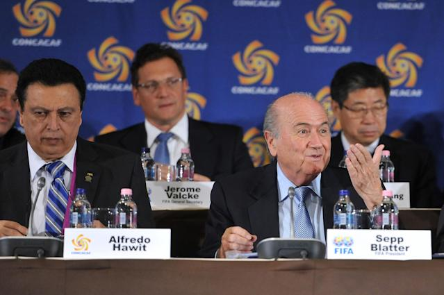 FIFA President Joseph Blatter reacts as he attends the meeting of the Confederation of North, Central American and Caribbean Association Football (CONCACAF), prior to the two-day congress of FIFA in Budapest, Hungary, Wednesday, May 23, 2012. Sitting at left is the interim head of CONCACAF Alfredo Hawit. (AP Photo/MTI, Szilard Koszticsak)