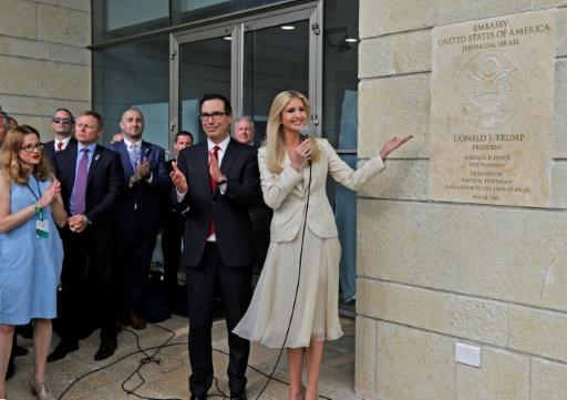US Treasury Secretary Steven Mnuchin claps as Ivanka Trump unveils a plaque during the opening of the US embassy in Jerusalem on May 14, 2018