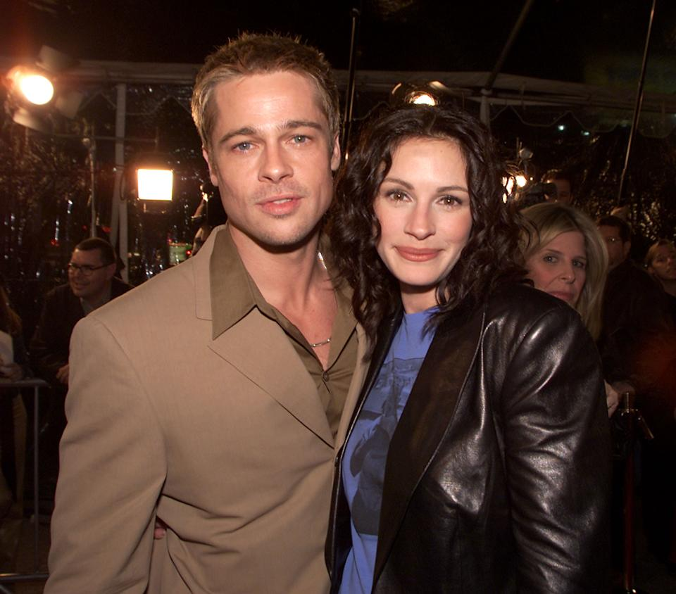 Brad Pitt and Julia Roberts at the premiere of 'The Mexican' at the National Theater in Los Angeles, Ca. 2/23/01.  (Photo by Kevin Winter/Getty Images).