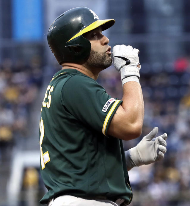 Oakland Athletics' Kendrys Morales celebrates on third base after driving in a run with a triple off Pittsburgh Pirates starting pitcher Trevor Williams during the first inning of a baseball game in Pittsburgh, Saturday, May 4, 2019. (AP Photo/Gene J. Puskar)