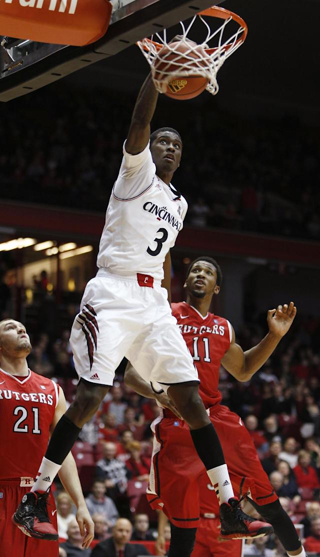 Cincinnati forward Shaquille Thomas (3) dunks against Rutgers forwards Kadeem Jack (11) and Stephen Zurich (21) during the second half of an NCAA college basketball game, Saturday, Jan. 11, 2014, in Cincinnati. Cincinnati won 71-51. (AP Photo/David Kohl)