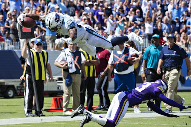 <p>DeMarco Murray #29 of the Tennessee Titans dives over Terence Newman #23 of the Minnesota Vikings into the end zone for a touchdown during the first half of the game at Nissan Stadium on September 11, 2016 in Nashville, Tennessee. (Photo by Wesley Hitt/Getty Images) </p>